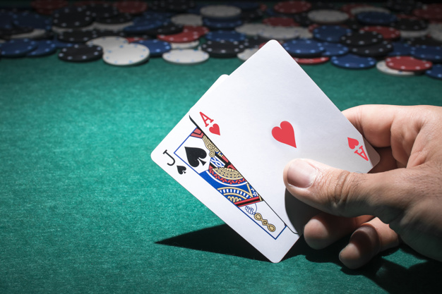 Premium Photo | Person's hand holding poker card in casino